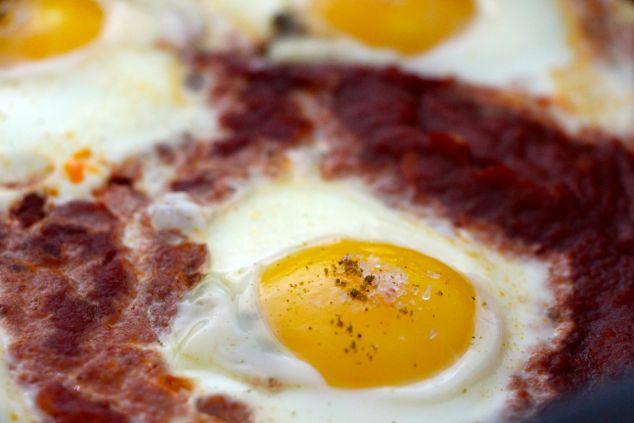 adding salt on each egg