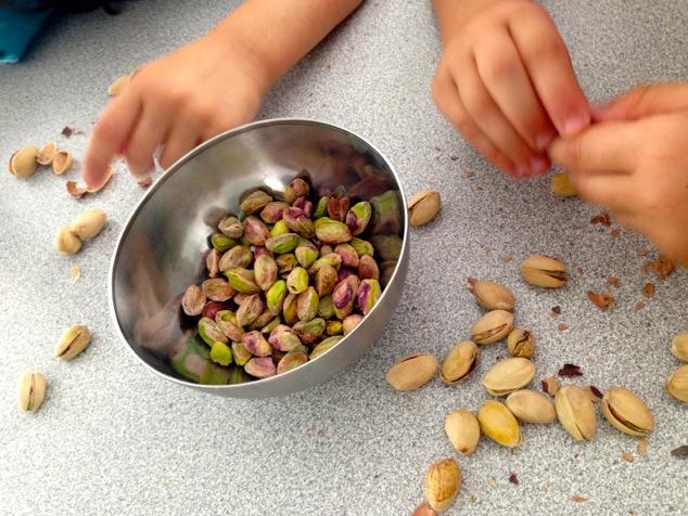 little hands peeling pistachios