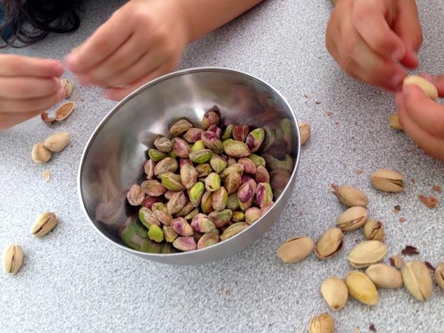 kids peeling pistachios