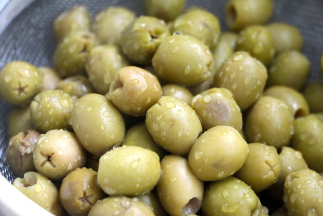 washing green olives