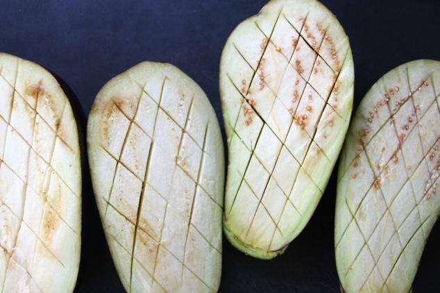 eggplants cut into checherboard slits