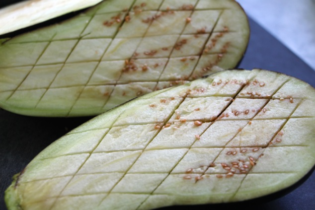eggplants slit into checkerboard up close