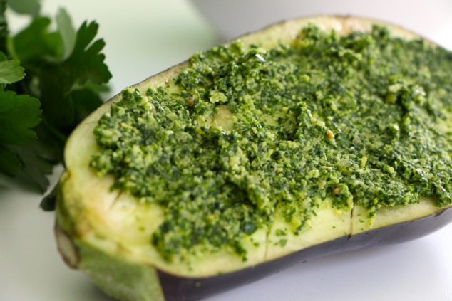 topping eggplant with pesto