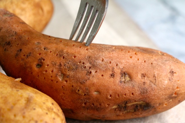 piercing sweet potato with fork