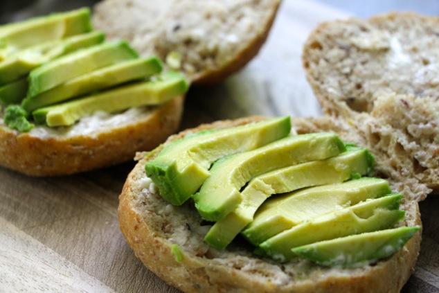 adding avocado onto sandwich