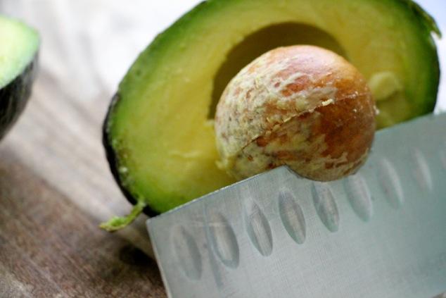 avocado removing pit up close