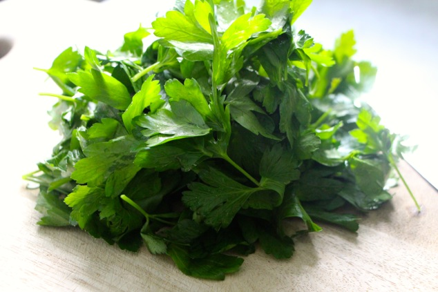 parsley leaves pile on a cutting board