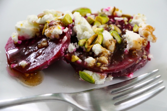 beet goat cheese pistachio salad served