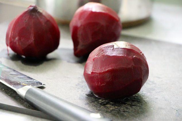 boiled beets onto cutting board