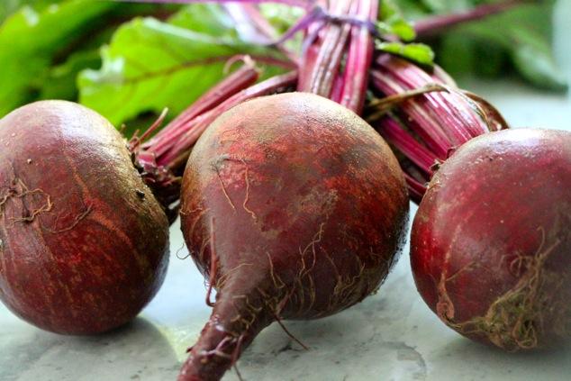 three fresh beets up close