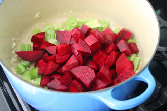 adding beet cubes to the pot