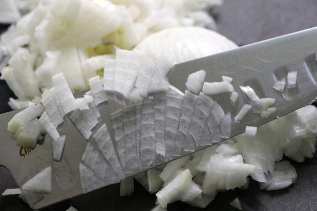 chopping onion up close
