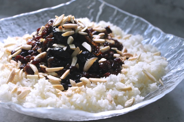 white rice and dried fruit in serving bowl