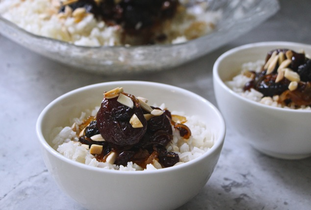 white rice and dried fruit in serving dishes