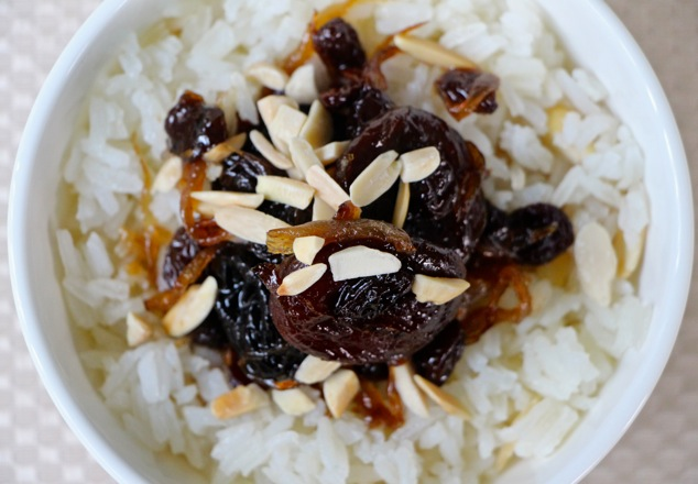 white rice and dried fruit served up close from above