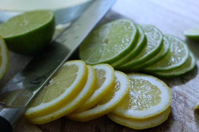 thinly sliced lemons and limes