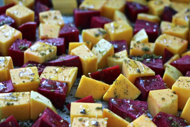 beets and butternut squash cubes with olive oil and zaatar on tray