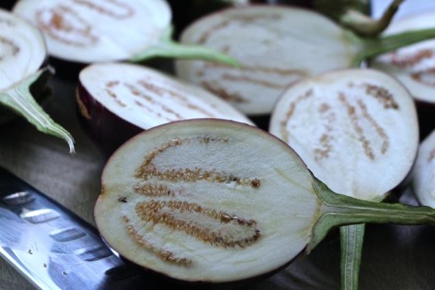 cutting indian eggplants in half