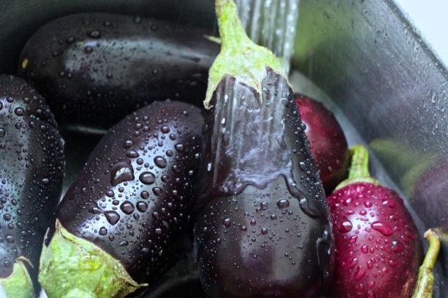 washing eggplants up close