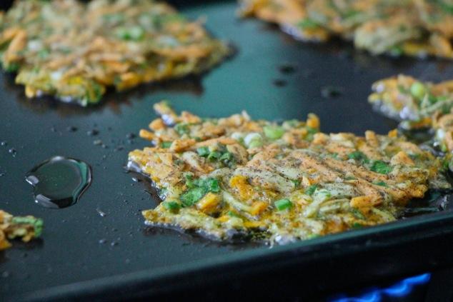 frying sweet potato kohlrabi latkes up close