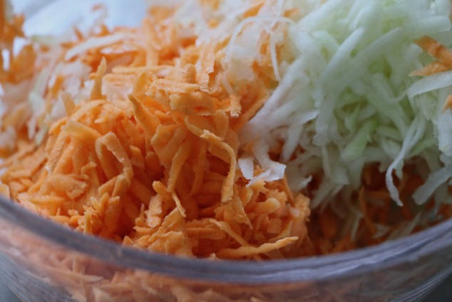 grated sweet potato and kohlrabi in a bowl