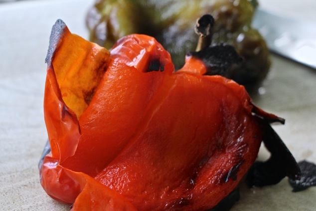 peeling roasted peppers up close