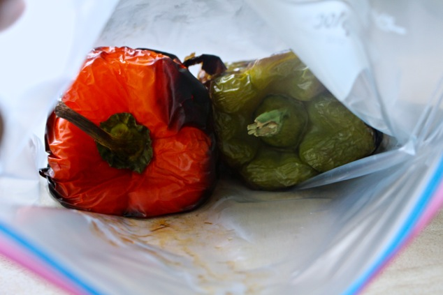 putting roasted peppers into a sealed bag