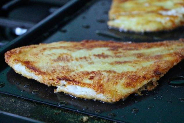 frying fish filets up close
