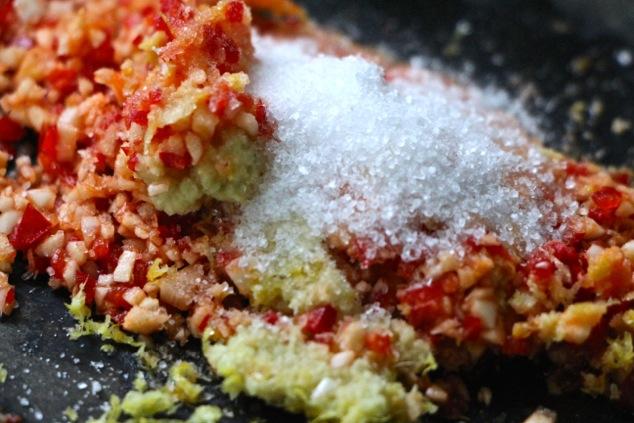 adding salt to hot red pepper mixture