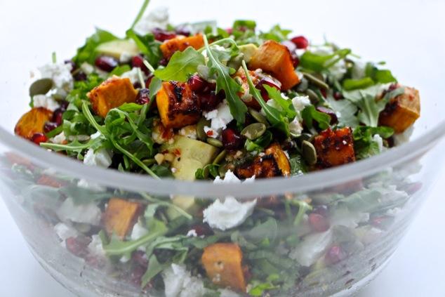 arugula sweet potato salad in a bowl