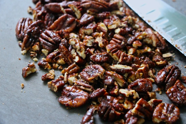 caramelized pecans on cutting board