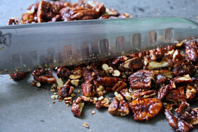chopping caramelized pecans