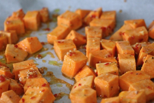 sweet potatoes on a baking sheet